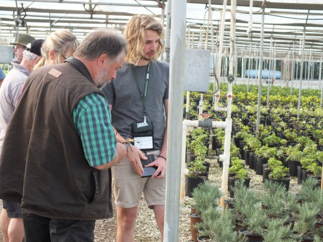 Clive Larkman (Australia Region and Ben Gregory (Great Britain) discuss propagation at Flowerwood Nursery.